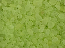 Lime scented bath crystals, closeup background Stock Images