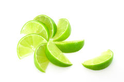 Lime segments fanned out. And isolated on white Stock Photography