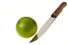 Lime with sharp knife Royalty Free Stock Image