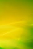 Lime shine. The background created by means of movement of silk fabrics on rather long shutter speed.  Lime shine Royalty Free Stock Photo