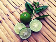 Lime slice on bamboo table royalty free stock photos
