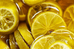 Lime slice in honey texture background. Stock Images