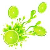 Lime slice with juice splash on white background Stock Photo