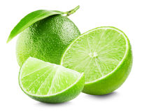 Lime with slice and leaf isolated on white background royalty free stock photos