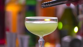 Lime slice slowly falls. stock footage