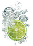 Lime slice in water Royalty Free Stock Photography