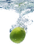 Lime slice in water stock photos