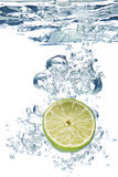 Lime slice in water Royalty Free Stock Photo