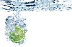 Lime slice in water Stock Images
