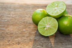 Lime slice on wood Royalty Free Stock Image