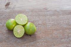 Lime slice on wood Stock Photography