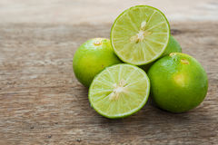 Lime slice on wood Stock Images
