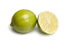 Lime and Sliced Lime Half on White Stock Photos