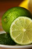 Lime, sliced on a plate Stock Photography