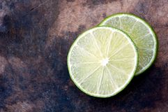 Lime. Sliced on wood block Royalty Free Stock Photography