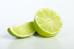 Lime slices. A half lime and a quarter lime on white background Stock Photo