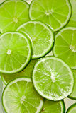 Lime slices. In the water Royalty Free Stock Photos