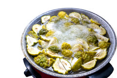 Lime slices boil. Lime slices boil in a saucepan electricity stock photography