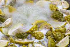 Lime slices boil. Lime slices boil in a saucepan electricity stock photos