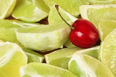 Lime Slices and Cherry. Cherry sits on top of key lime slices Stock Photo