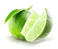 Lime with slices isolated on the white background stock image