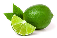 Lime with slices and leaf isolated on white background stock image