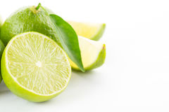 Lime with slices and leaves isolated. On white background Stock Images