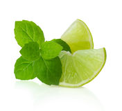 Lime slices and mint leaves isolated on white Royalty Free Stock Images