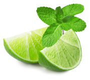 Lime slices with mint leaves isolated on the white background stock image