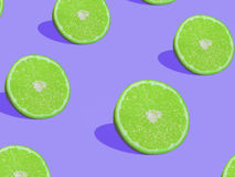 Lime slices on purple background, pop art style.  Royalty Free Stock Photo