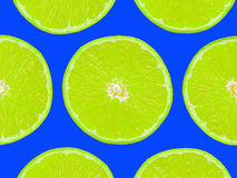 Lime slices on purple background, pop art style.  Stock Photo
