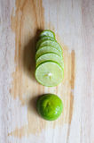 Lime slices. On top wood Stock Image