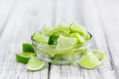 Lime Slices & x28;selective focus& x29; on vintage wooden background Stock Photo