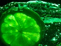 Lime in soda Royalty Free Stock Image