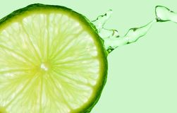 Lime Splash on Green Royalty Free Stock Image