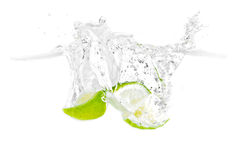 Lime splashing Stock Images