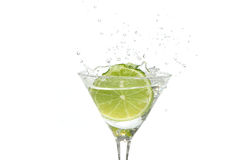 Lime splashing into a cocktail Royalty Free Stock Photos