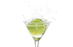 Lime splashing into a cocktail royalty free stock photos