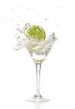 Lime Splashing Into A Cocktail Stock Photography