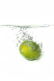 Lime Splashing in water Stock Images