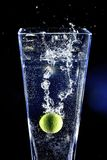Lime splashing into a water Stock Images