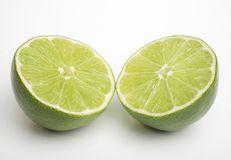Lime split. Lime cut in half showing both halves on white Stock Photos