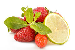 Lime, strawberry and mint leaves Stock Photography