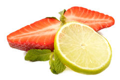 Lime, strawberry and mint leaves Stock Images