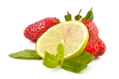 Lime, strawberry and mint leaves Royalty Free Stock Photography