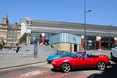 Lime Street Railway Station and Sports Cars. Royalty Free Stock Image