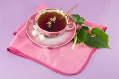 Lime tea. Tea with lime in a cup on a napkin Royalty Free Stock Photos
