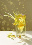 Lime tea and linden flowers. Glass of lime tea and linden flowers, summertime Stock Photography