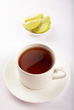 Lime tea served in white cup Stock Photos