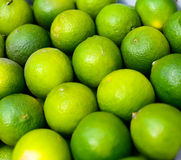Lime Texture. Green yellow pile of limes texture Stock Photo